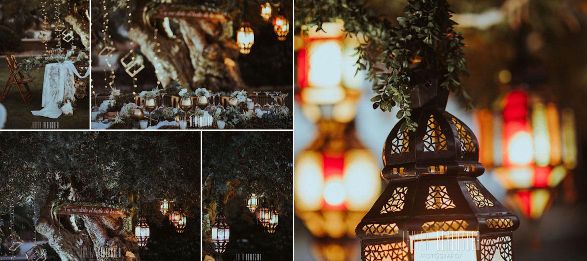 decoracion con lamparas y mesa de madera en bodas