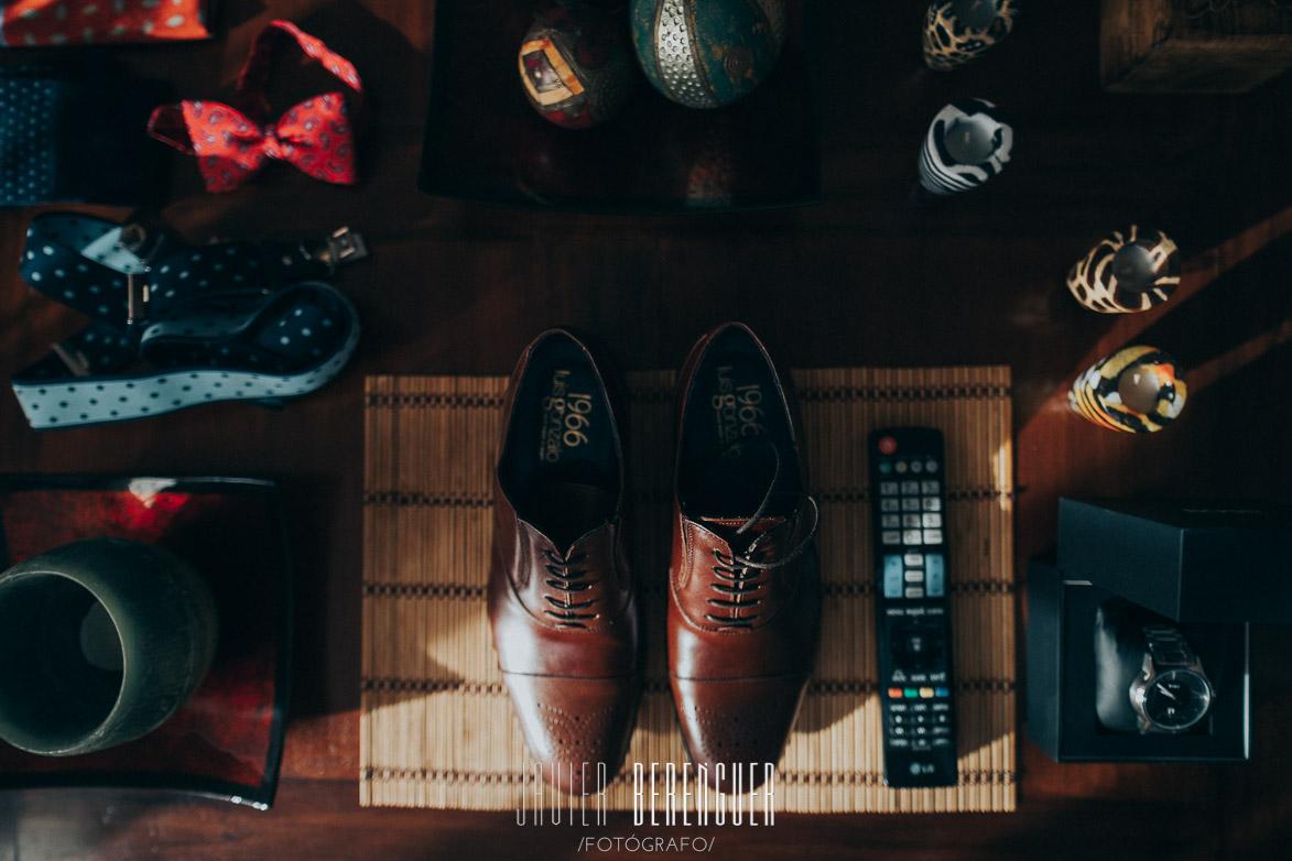 Composición detalles casa novio zapatos